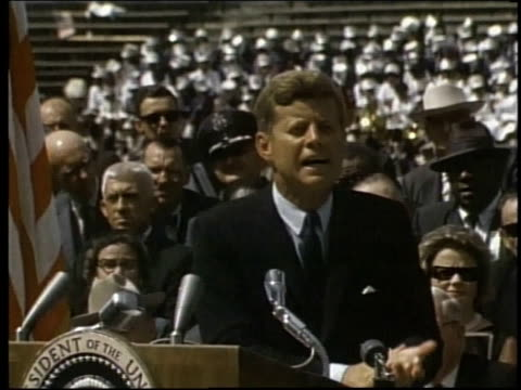 president john f kennedy speaking at rice university concluding speech and audience standing and cheering / houston texas united states - john f. kennedy politik stock-videos und b-roll-filmmaterial