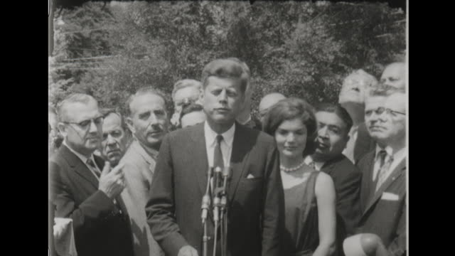 president john f kennedy speaks to press about the iron curtain - 冷戦点の映像素材/bロール