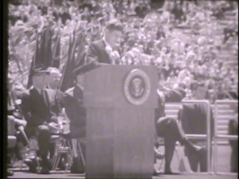 president john f kennedy standing at podium in falcon stadium during graduation ceremony delivering speech about graduates air force freedom service... - john f. kennedy us president stock videos and b-roll footage