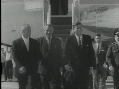 us president john f kennedy vice president lyndon johnson and astronaut john glenn walk away from the president's plane near cape canaveral florida... - 1962 stock videos & royalty-free footage