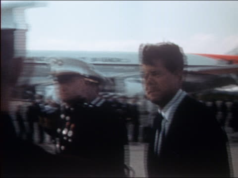 president john f. kennedy walking in front of honor guard onboard uss enterprise - 1962年点の映像素材/bロール