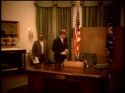 president john f kennedy walking to a desk / washington dc united states - 1963 stock videos & royalty-free footage