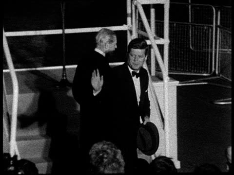 president john f kennedy walks next to prime minister harold macmillan and waves to crowd as he leaves london; 06 jun 61 - john f. kennedy us president stock videos & royalty-free footage