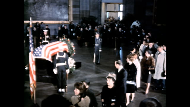 president john f kennedy's coffin lies in state at capitol building / crowds of people view the coffin / aerial view of the coffin surrounded by... - coffin stock videos & royalty-free footage