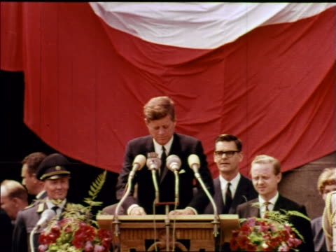 president john kennedy at podium making ich bin ein berliner / berlin / newsreel - john f. kennedy politik stock-videos und b-roll-filmmaterial