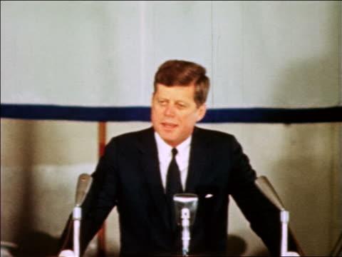 vídeos de stock e filmes b-roll de president john kennedy at podium making speech to us navy / industrial - só um homem de idade mediana