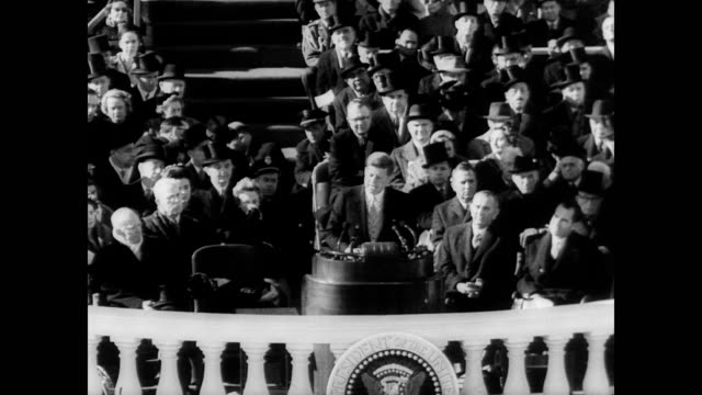 / president john kennedy gives his inaugural address / 'let every nation know, whether it wishes us well or ill, that we shall pay any price, bear... - john f. kennedy us president stock videos & royalty-free footage