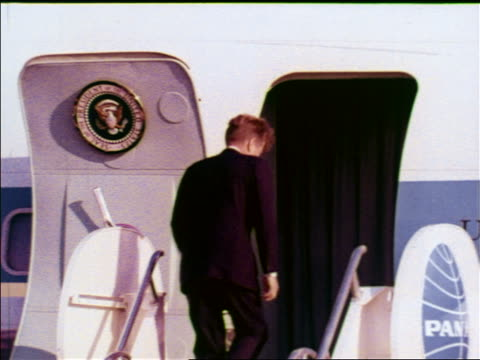 president john kennedy walks up stairs + stops in doorway of air force one to wave / berlin - john f. kennedy us president stock videos & royalty-free footage