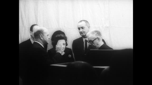 president johnson and first lady lady bird johnson watch as robert c weaver is sworn in as the first african american cabinet member as secretary of... - oath stock videos and b-roll footage