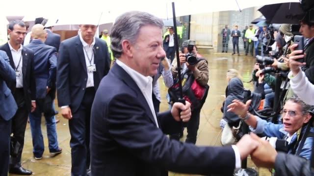 president juan manuel santos casts his vote for peace referendum in bogota colombia, shot on 30th september 2016. - juan manuel santos stock videos & royalty-free footage