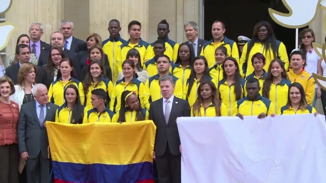 president juan manuel santos delivers the colombian flag and a white flag of peace to the delegation of athletes that will participate in the olympic... - colombian flag stock videos and b-roll footage