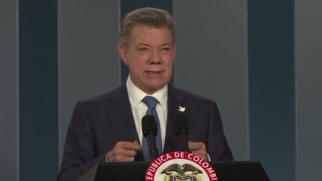 president juan manuel santos voiced optimism wednesday that colombia can end a half century war with the farc rebels after meeting the top opponent... - juan manuel santos stock videos & royalty-free footage