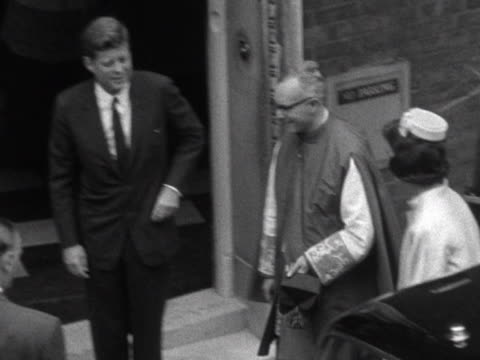 president kennedy and jacqueline kennedy arrive at westminster cathedral for the christening of their niece, anna christina. - westminster cathedral stock videos & royalty-free footage