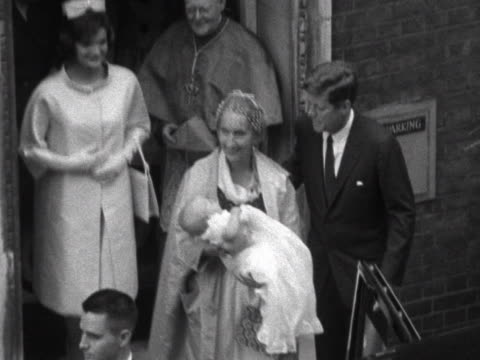 stockvideo's en b-roll-footage met president kennedy and jacqueline kennedy leave westminster cathedral following the christening of their niece anna christina - jacqueline kennedy