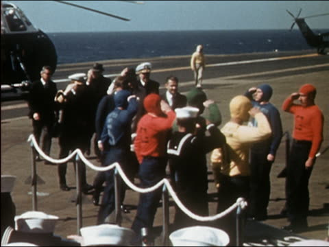 president kennedy and robert mcnamara greeting officers on deck of aircraft carrier - 1962年点の映像素材/bロール