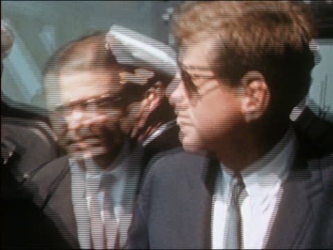 president kennedy and robert mcnamara walking toward cam on deck of navy ship - john f. kennedy us president stock videos & royalty-free footage
