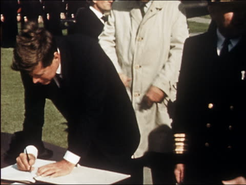 president kennedy and vp johnson signing book upon arrival at nato atlantic command center - 1962年点の映像素材/bロール