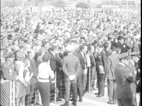 / president kennedy finishes his speech clapping / crowds watching / jfk leaves stage / governor john connally and wife nellie in open top limousine... - john connally stock videos & royalty-free footage