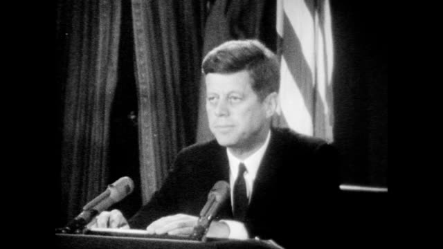 president kennedy speaks to the nation to inform americans of recently discovered soviet military buildup in cuba including the ongoing installation... - john f kennedy video stock e b–roll