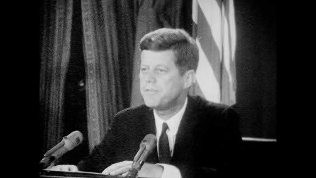 vídeos y material grabado en eventos de stock de president kennedy speaks to the nation to inform americans of recently discovered soviet military buildup in cuba including the ongoing installation... - 1962