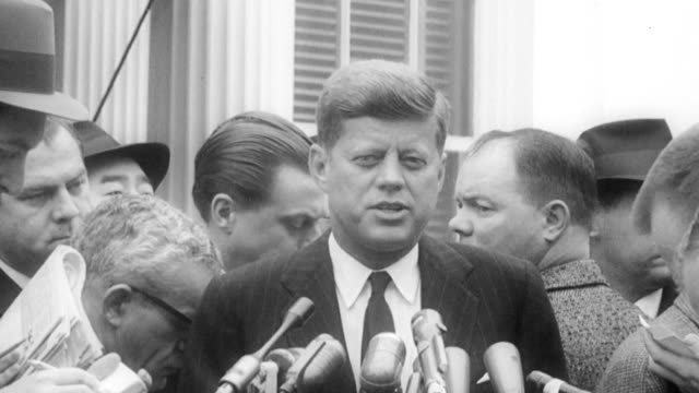 president kennedy speaks to the press explaining his conversation with eisenhower regarding the details of the administration hand over / reporter... - john f. kennedy us president stock videos & royalty-free footage