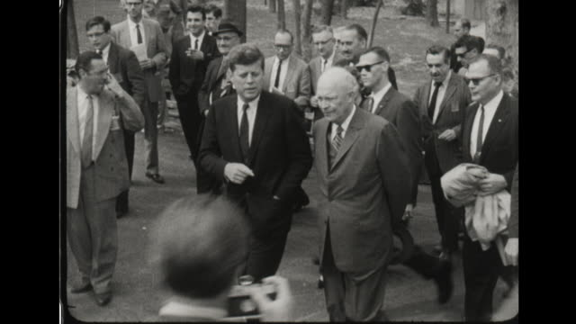 president kennedy with president dwight eisenhower at camp david - anno 1960 video stock e b–roll