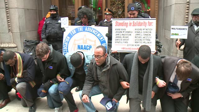 president leads prayer at police reform rally in front of chicago city hall on november 30 2015 in chicago illinois - naacp stock videos & royalty-free footage