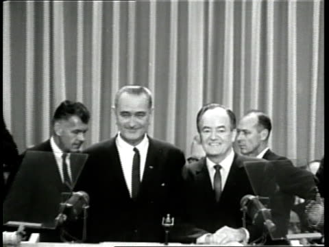 vídeos de stock, filmes e b-roll de us president lyndon b johnson and us senator hubert humphrey smile as they accept the presidential candidate nomination during the 1964 democratic... - 1964
