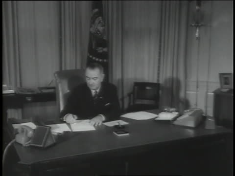u.s. president lyndon b. johnson signs documents in the oval office of the white house following the assassination of john f. kennedy. - us president stock videos & royalty-free footage