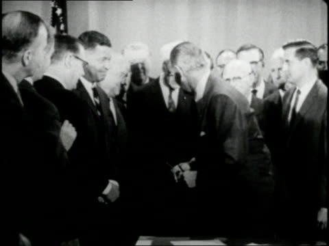 stockvideo's en b-roll-footage met us president lyndon johnson signs the national voting rights act in 1965 - 1965