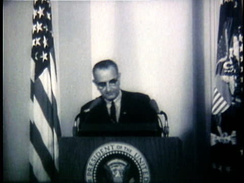 vídeos de stock, filmes e b-roll de president lyndon johnson speaking at podium during television broadcast regarding the gulf of tonkin incident / washington dc united states - 1964
