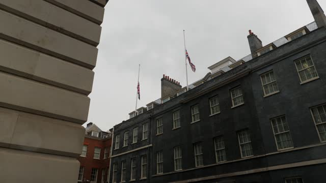 president magufuli of tanzania dies: gvs of flags at half mast; england: london: westminster: ext various shots of union flags flying at half-mast... - flag stock videos & royalty-free footage