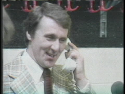 president make a phone call to hockey teams coach to congratulate them - sport stock-videos und b-roll-filmmaterial