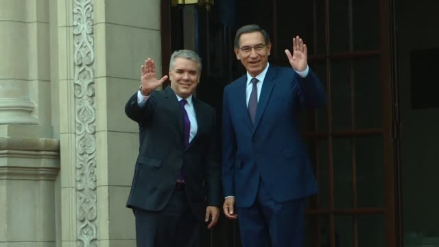 President Martin Vizcarra of Peru greets Ivan Duque president of Colombia ahead of a bilateral meeting at the Government Palace in Lima