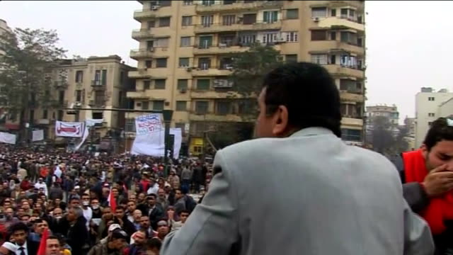 President Mubarak clings to power as ruling party leadership resign EGYPT Cairo EXT Large crowd of antigovernment protesters chanting slogans at...