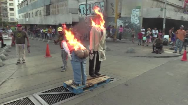 vídeos y material grabado en eventos de stock de president nicolas maduro, opposition leader juan guaido donald trump and the blackout that plunged venezuela into darkness are some of the characters... - judas