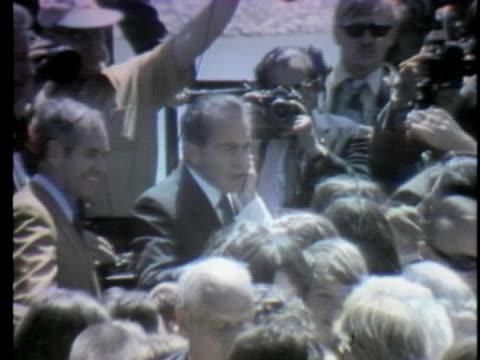 president nixon shakes hands with crowd during a dam dedication in centerville, iowa - demokrati bildbanksvideor och videomaterial från bakom kulisserna