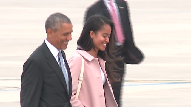 WGN President Obama and Daughter Malia get off Marine One Helicopter and Board Air Force One at the Chicago O'Hare International Airport on April 7...
