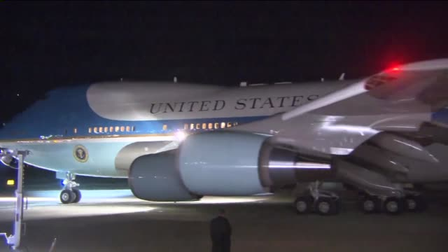 KTLA President Obama and Michelle Obama depart San Bernardino International Airport after visiting with family members of those killed in the...