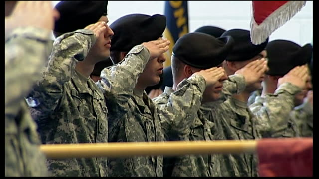 president obama announces cuts in defence budget; t02120902 new york: westpoint: us troops salute us flag at parade as us national anthem played - saluting stock videos & royalty-free footage