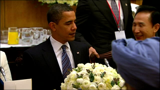 President Obama arrives in London for G20 meeting Shows interior shots Barack Obama taking his seat in the dining room sitting with Angela Merkel on...