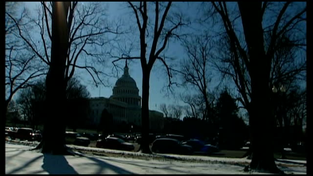 President Obama meets Prime Minister Gordon Brown Washington Capitol Building with winter trees in foreground Washington Monument with snow on ground...