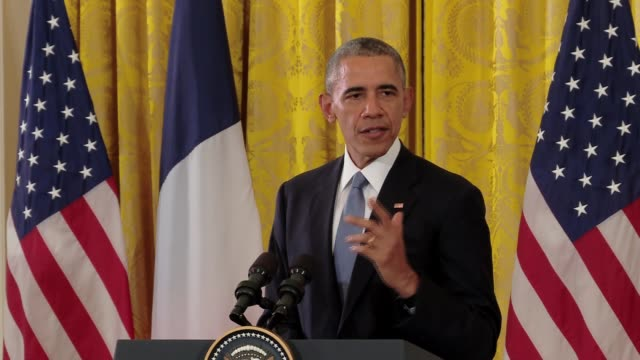 president obama says the world has faced greater threats before, with french president francois hollande by his side, including awkward side hug.... - françois hollande stock videos & royalty-free footage