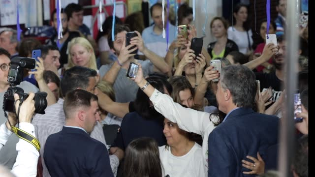 president of argentina and presidential candidate mauricio macri of 'juntos por el cambio' poses for photos with supporters after casting his vote... - mauricio macri stock videos and b-roll footage