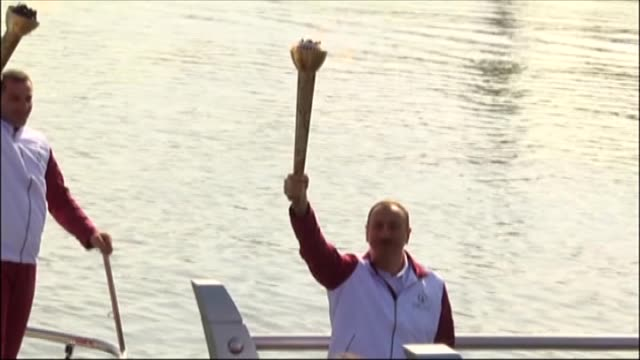 President of Azerbaijan Ilham Aliyev receives the Olympic torch after it was travelled across 60 districts of the country with total of 5500...