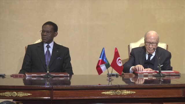 president of equatorial guinea teodoro obiang nguema and tunisian president beji caid el sebsi attend a bilateral agreement ceremony at the carthage... - carthage tunisia stock videos & royalty-free footage