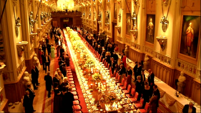 president of ireland visit: state banquet; major chatting with others / banqueting hall / day lewis along / various of guests standing chatting and... - state dinner stock videos & royalty-free footage