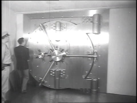 vídeos de stock, filmes e b-roll de president of iron mountain atomic storage vaults, herman knaust, opening 30-ton door guarding main passage to 400 vaults in underground storage... - 1951