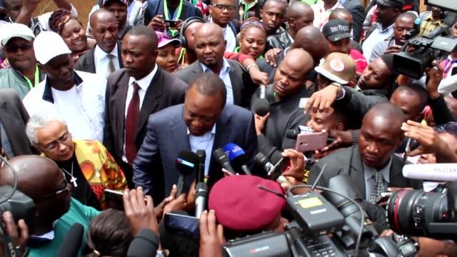 President of Kenya Uhuru Kenyatta casts his vote during the general elections at a polling station in Nairobi Kenya on August 08 2017 Millions of...