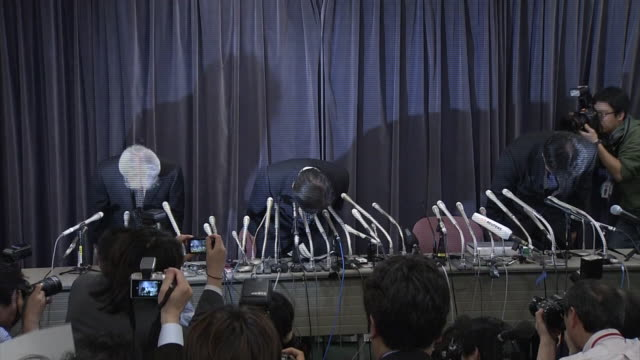 president of mitsubishi motors tetsuro aikawa and 2 other company executives bowing in apology at a press conference at hall in the building of mlit... - reconciliation stock videos & royalty-free footage